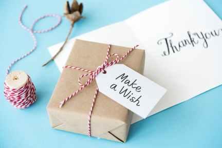 brown gift box beside thread