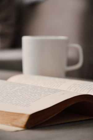 white book beside white mug