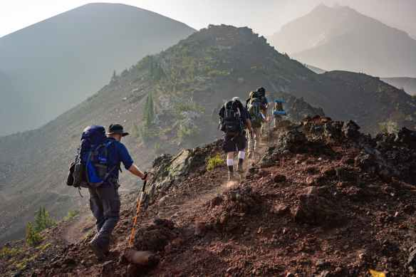 group of person walking in mountain