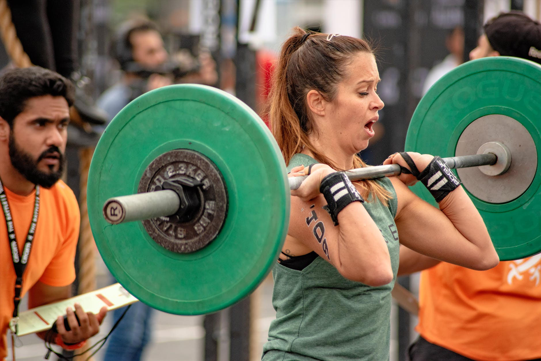 photo of a woman lifting a barbell