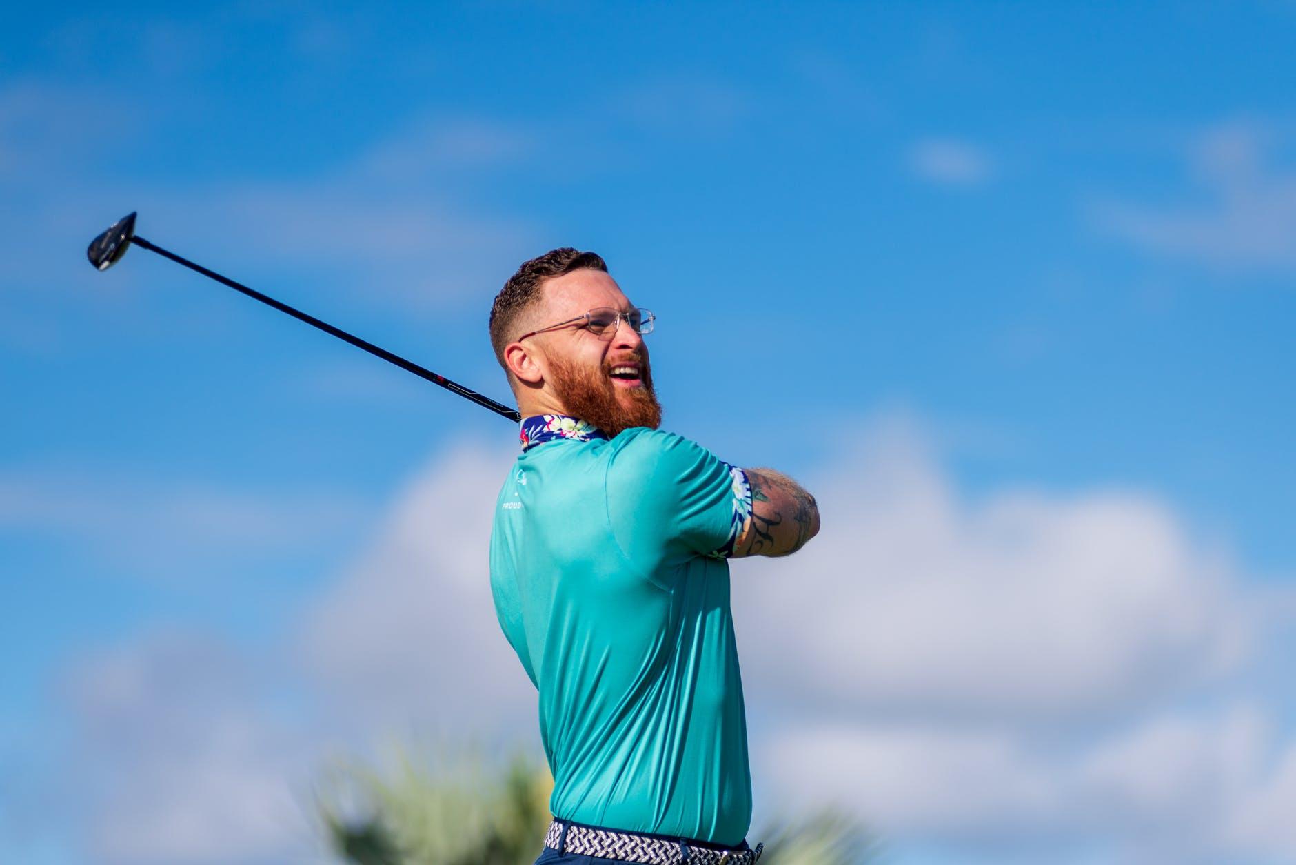 photo of man playing golf