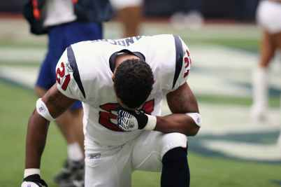 football player on bended knees