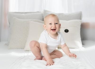 laughing baby wearing white shirt