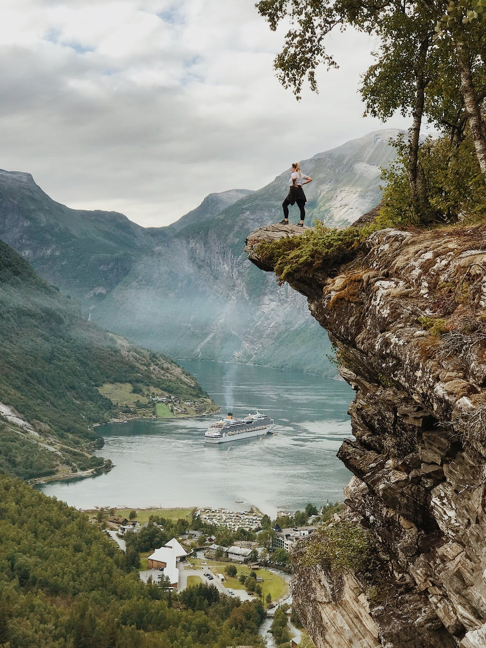 woman standing on the cliff