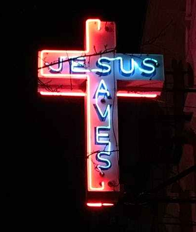 jesus saves neon signage