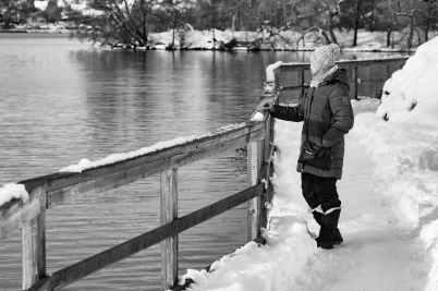 man standing on riverbank