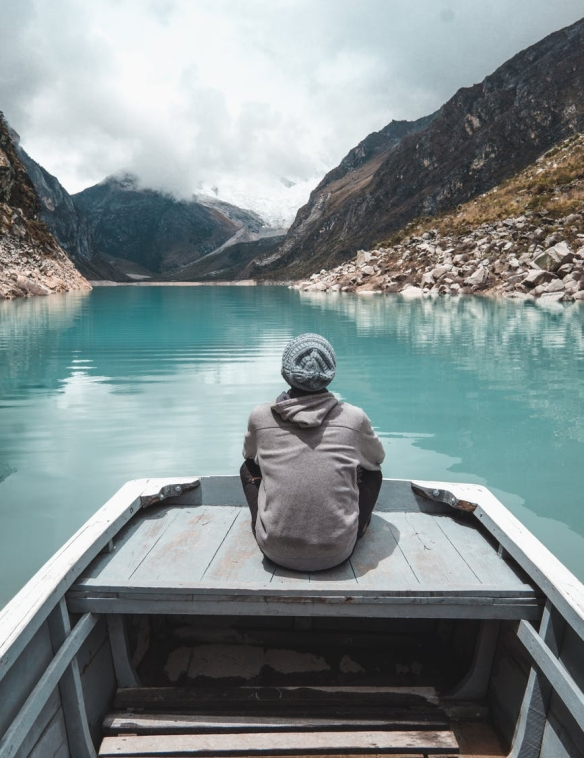 photo of man sitting on boat