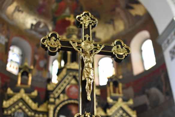 gold and black crucifix