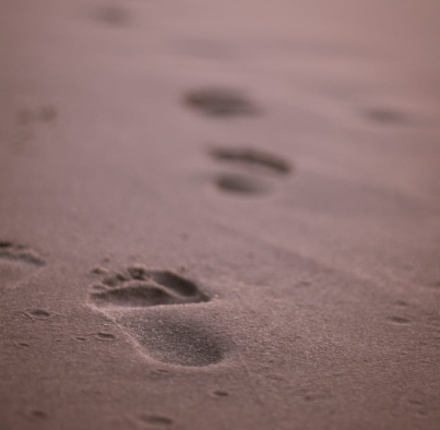 close up photo of footprints on sand