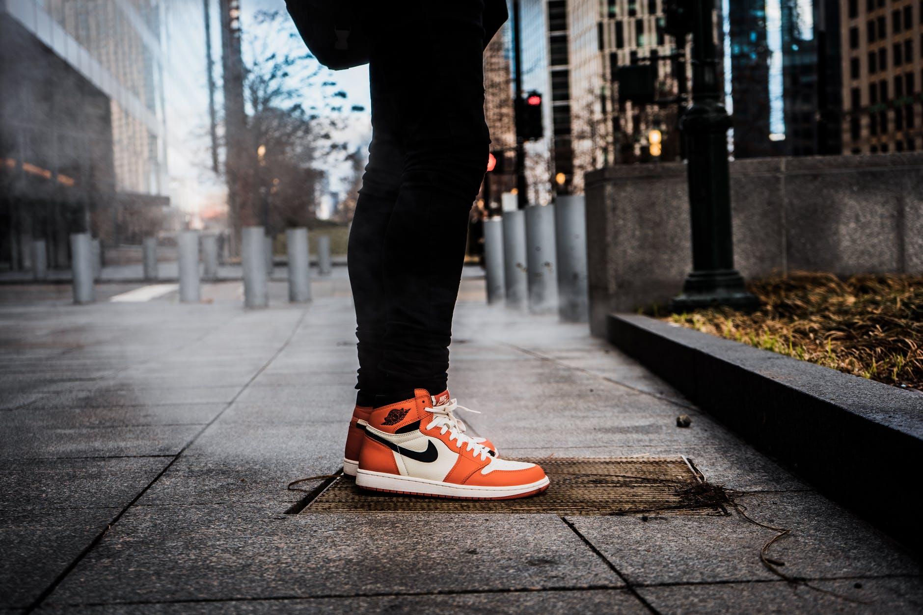 pair of white and orange nike sneakers
