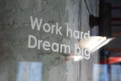 work hard dream big writing on glass case