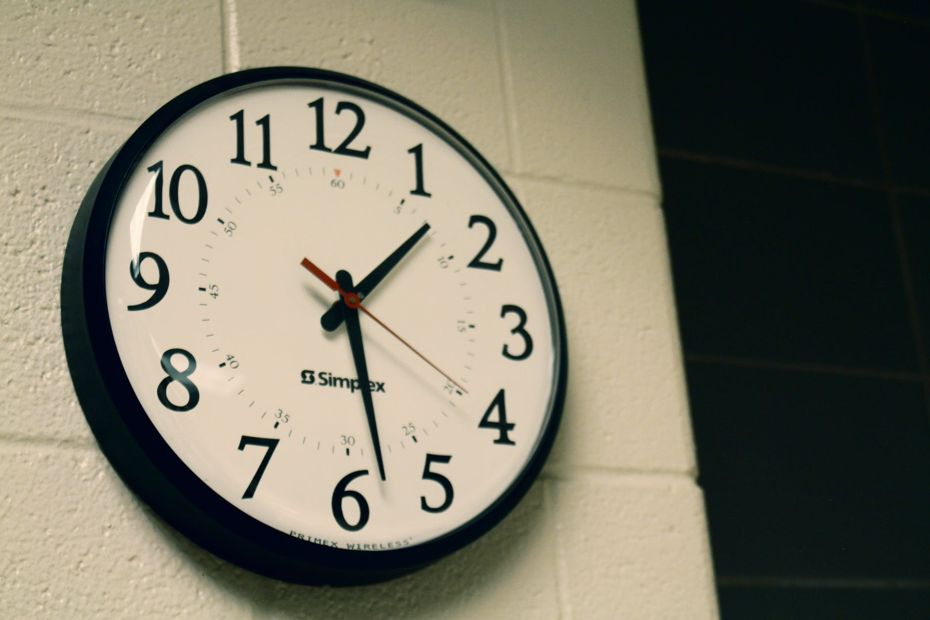 round black analog wall clock