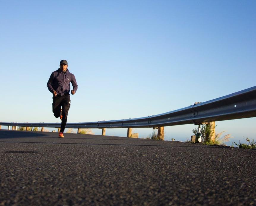 photo of man running during daytime