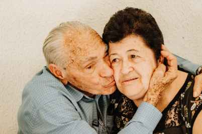 man kissing woman s cheek