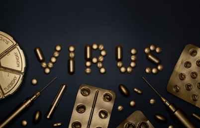 syringe and pills on blue background