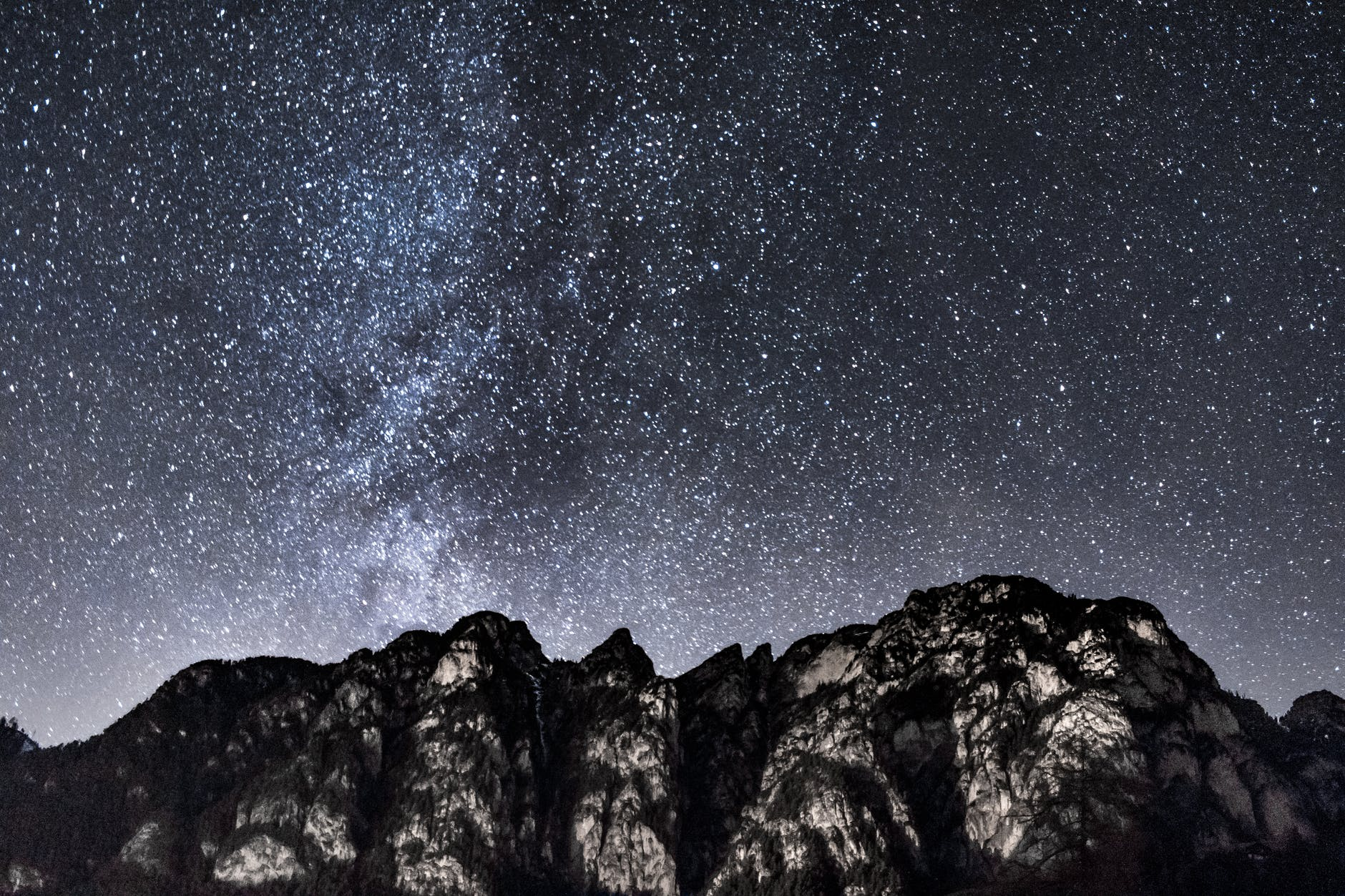 mountain under starry sky during nighttime